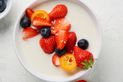 Banana smothie bowl with berry Stock Photography