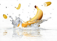 Banana splashing into clear water. Royalty Free Stock Photos