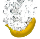 Banana splashing into water Royalty Free Stock Image