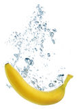 Banana splashing into water Stock Photo