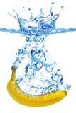 Banana splashing into water Stock Image