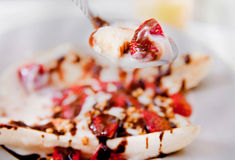 Banana split bite Stock Photography