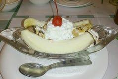 Banana split with spoons. A dish of banana split icecream with spoons Stock Image