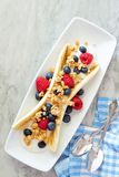 Banana split with yogurt, berries and granola, above on marble Royalty Free Stock Image