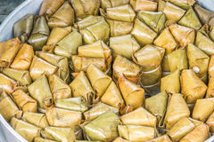 Banana with sticky rice. Covered in banana leaf (khao tom mat) in steamer, Traditional Thai food style Royalty Free Stock Photos