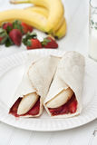 Banana and strawberry burritos Royalty Free Stock Photography
