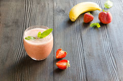 Banana-strawberry smoothie. On dark wooden background. Healthy food, Diet, Detox, Clean Eating or Vegetarian concept. Copy space background stock photos