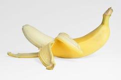 Banana su una priorità bassa bianca Fotografia Stock Libera da Diritti