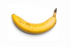 Banana su una priorità bassa bianca Fotografie Stock Libere da Diritti
