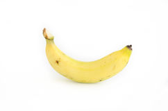 Banana su una priorità bassa bianca Immagini Stock Libere da Diritti