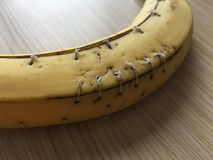 Banana with surgical sutures and knots Stock Photography
