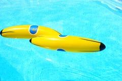 Banana in swimming pool Stock Photos
