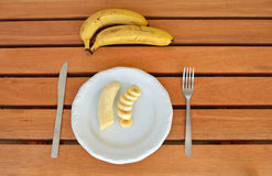 Banana on the table. Banana on a white plate on the table Royalty Free Stock Photos