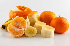 Banana and tangerine. Isolater on white background Stock Photos