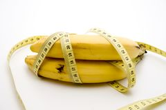 Banana with tape measure Stock Image