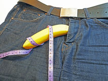 Banana and tape measure like the penis Stock Photography