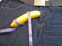 Banana and tape measure like the penis Royalty Free Stock Photo