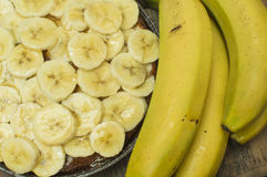 Banana tart. Placing the sliced bananas on the tart Stock Images