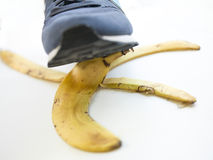 Banana trap. Prone to falling when stepping on a banana peel Stock Photos