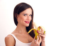 Attractive Woman Peels Banana For Sweet Treat Stock Image