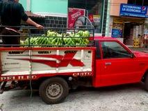 Banana truck in ecuador. BANOS, ECUADOR - MARCH 23, 2016:  a truck carrying a load of bananas is seen in the streets of Banos de Agua Santa, Ecuador Royalty Free Stock Photography