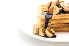 Banana waffle with chocolate. On white background Royalty Free Stock Photo