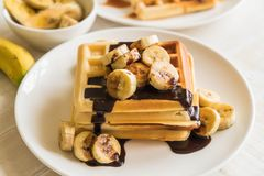 Banana waffle with chocolate Stock Photos