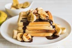 Banana waffle with chocolate. On white plate Stock Image