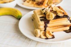 Banana waffle with chocolate. On white plate Stock Photo
