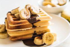 Banana waffle with chocolate. On white plate Royalty Free Stock Photography
