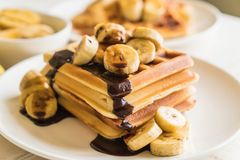 Banana waffle with chocolate Stock Photo