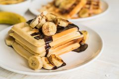 Banana waffle with chocolate. On white plate Royalty Free Stock Image