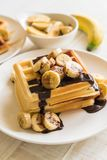 Banana waffle with chocolate. On white plate Royalty Free Stock Photo