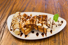 Banana Waffle with whip cream on wooden table Stock Photography