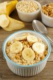 Banana walnut oatmeal on wood table Stock Photography
