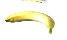 Banana in Water. A banana under water, on white background Stock Photography