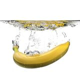 Banana with water splash Royalty Free Stock Images