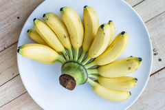Banana on white plate Stock Photography