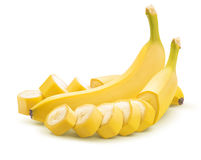Banana whole and cut unpeeled  on white background Royalty Free Stock Photos