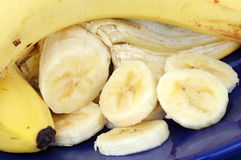 Banana, whole, peeled and slices Stock Images