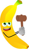Banana with a wooden hammer Royalty Free Stock Image