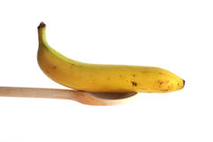 Banana on a wooden spoon Royalty Free Stock Images