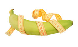 Banana with yellow measure tape Royalty Free Stock Photography