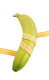 Banana with yellow measure tape Royalty Free Stock Images