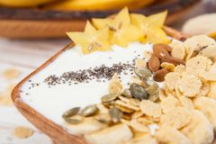 Banana yoghurt with seeds and cornflakes Royalty Free Stock Photography