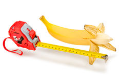 Bananameter. A ripe banana, the length of which decided to learn with tape-measure stock images