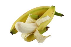 Bananas. Two bananas with one half peeled Royalty Free Stock Images