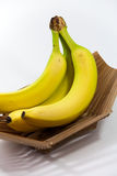 Three Bananas in Wooden Bowl Stock Photos