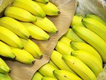 Bananas. In a banana box Stock Photos