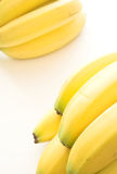 Bananas. Two bunches of bananas set on a white background stock image